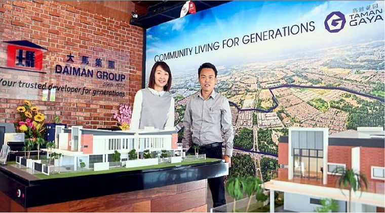 Daiman Development Bhd sales and marketing manager Irene yeoh (left) with property development general manager Heng Song Teck at the company's new sales gallery in Taman Gaya.